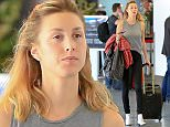 Please contact X17 before any use of these exclusive photos - x17@x17agency.com   Whitney Port traveling to New York wearing no make up and a tank top at LAX February 9, 2015 X17online.com