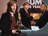 Beck accepts the award for album of the year for ìMorning Phaseî at the 57th annual Grammy Awards on Sunday, Feb. 8, 2015, in Los Angeles. (Photo by John Shearer/Invision/AP)