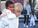 Picture Shows: Charlize Theron, Jackson Theron  February 09, 2015    'Mad Max: Fury Road' actress Charlize Theron spotted taking her son Jackson to his karate class in Los Angeles, California.    Jackson was excited to give his mother a big hug as she tried to put him in the car.     Exclusive - All Round  UK RIGHTS ONLY    Pictures by : FameFlynet UK    2015  Tel : +44 (0)20 3551 5049  Email : info@fameflynet.uk.com