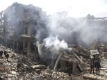People inspect a site hit by what activists said were airstrikes by forces loyal to Syria's President Bashar al-Assad in the Douma neighborhood of Damascus, February 9, 2015. REUTERS/ Bassam Khabieh (SYRIA - Tags: CIVIL UNREST CONFLICT)