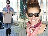 Please contact X17 before any use of these exclusive photos - x17@x17agency.com   Julia Roberts shopping for a gift at Cross Creek in malibu where she flashes her pearly whites wearing a frumpy dress, scarf and black spandex pants February 9, 2015 X17online.com