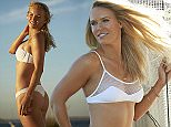 CAPTIVA ISLAND, FL - NOVEMBER 12: Swimsuit Issue 2015: Tennis player Caroline Wozniacki poses for the 2015 Sports Illustrated Swimsuit issue on November 12, 2014 on Captiva Island, Florida. Swimsuit by Issa De Mar. PUBLISHED IMAGE. ON EMBARGO IN NORTH AMERICA UNTIL UNTIL MAY 11, 2015. CREDIT MUST READ: Walter Iooss Jr. /Sports Illustrated/Contour by Getty Images. (Photo by Walter Iooss Jr. /Sports Illustrated/Contour by Getty Images)