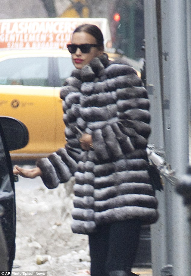 Still chic: The star didn't skimp on the chic look, covering up against the cold in a chinchilla overcoat