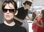 Violet Affleck feeds Jennifer Garner some frozen yogurt after being picked up from school with Seraphina in Brentwood. February 9, 2015 X17online.com