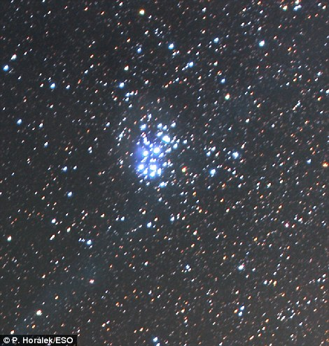 Also visible is the famous star cluster known as Pleiades, shown, also known as Seven Sisters, and designated Messier 45 (M45)