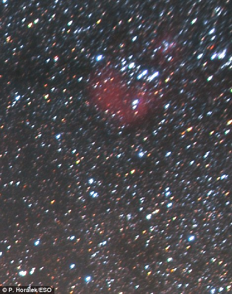 In the top right of the image, shown, is a red blur that is 1,500 light-years from Earth, known as IC 405 or the Flaming Star Nebula