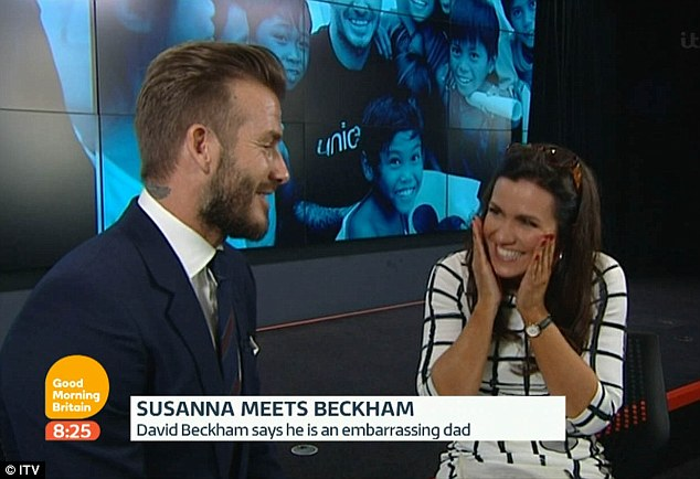 Giddy: Susanna Reid couldn't hide her flirtatious behaviour as she interviewed David Beckham for Good Morning Britain