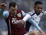 Burnley's Dean Marney and West Bromwich Albion's Stephane Sessegnon