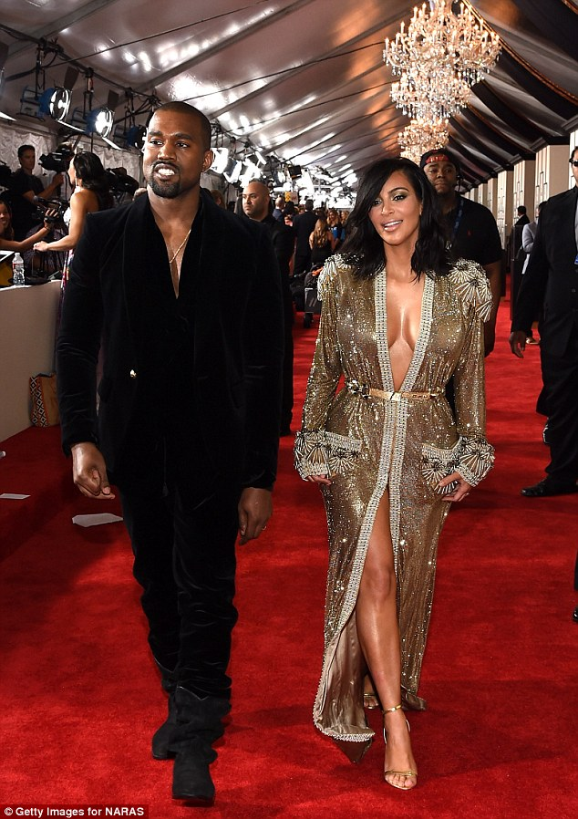 Kanye's creation: The reality star turned heads in a stunning Jean Paul Gaultier metallic gown at the Grammy Awards on Sunday night and revealed her husband was responsible for her outfit choice