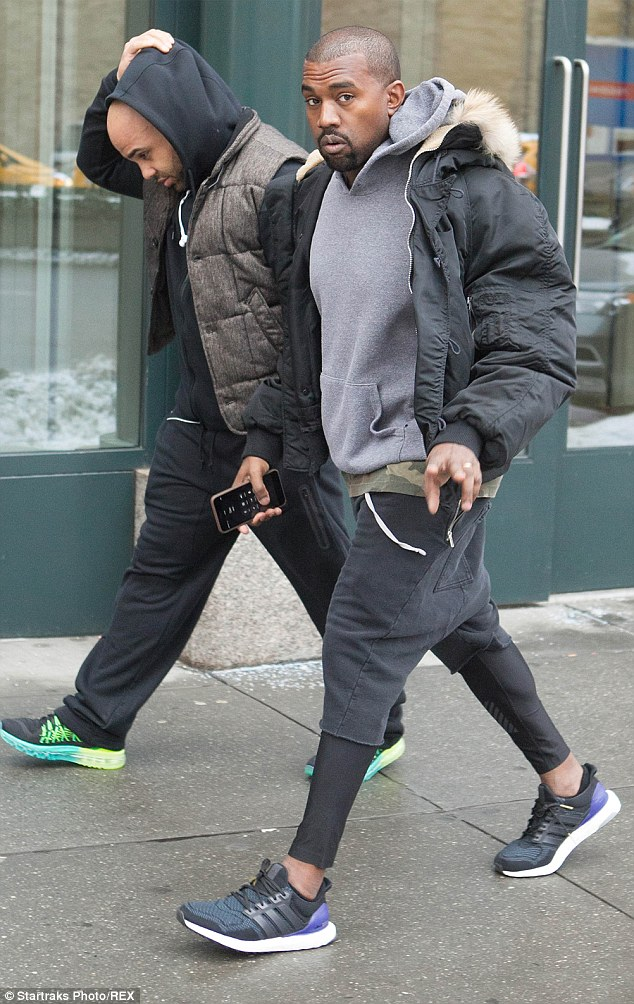 Time to sweat: As his wife showed off her snakeskin, Kanye was headed out for what appeared to be a workout on Tuesday