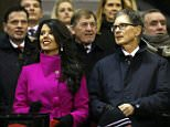 Liverpool owner John Henry, right, and his wife Linda Pizzuti arrive for the English Premier League soccer match between Liverpool and Tottenham Hotspur at Anfield Stadium, Liverpool, England, Tuesday Feb. 10, 2015. (AP Photo/Jon Super)
