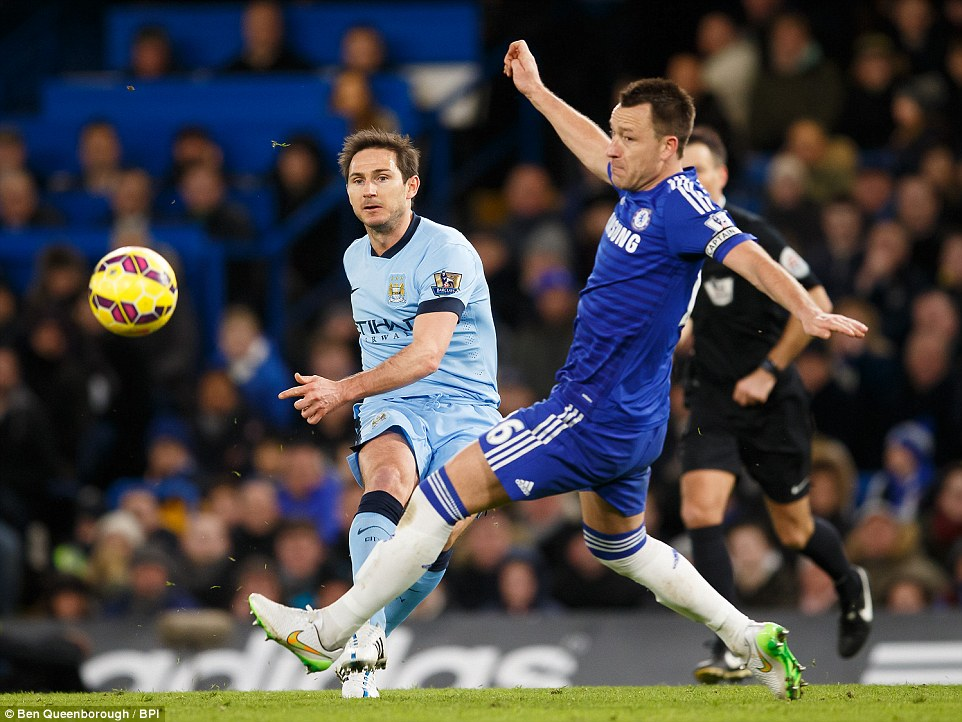 Lampard (left), in action for Manchester City against former club Chelsea on January 31, with whom he spent 13 years as a player