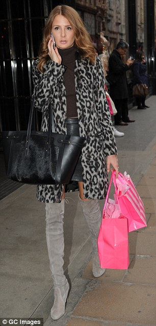 Meanwhile: Millie sported a smart leopard print coat over an on-trend roll neck sweater and black leather miniskirt, Millie caught the eye as she made her way into Victoria's Secret – where she splashed out on raunchy lingerie items
