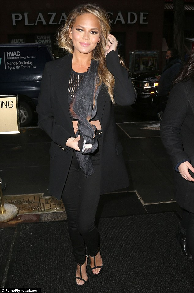 'I had no idea Kanye was serious': Chrissy Teigen - pictured on Tuesday leaving the Today show in New York - has revealed her love for Beck as she admits rapper West 'got a little dark' at the Grammy Awards