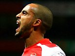 LONDON, ENGLAND - FEBRUARY 10:  Theo Walcott of Arsenal celebrates after scoring his team's second goal during the Barclays Premier League match between Arsenal and Leicester City at Emirates Stadium on February 10, 2015 in London, England.  (Photo by Richard Heathcote/Getty Images)