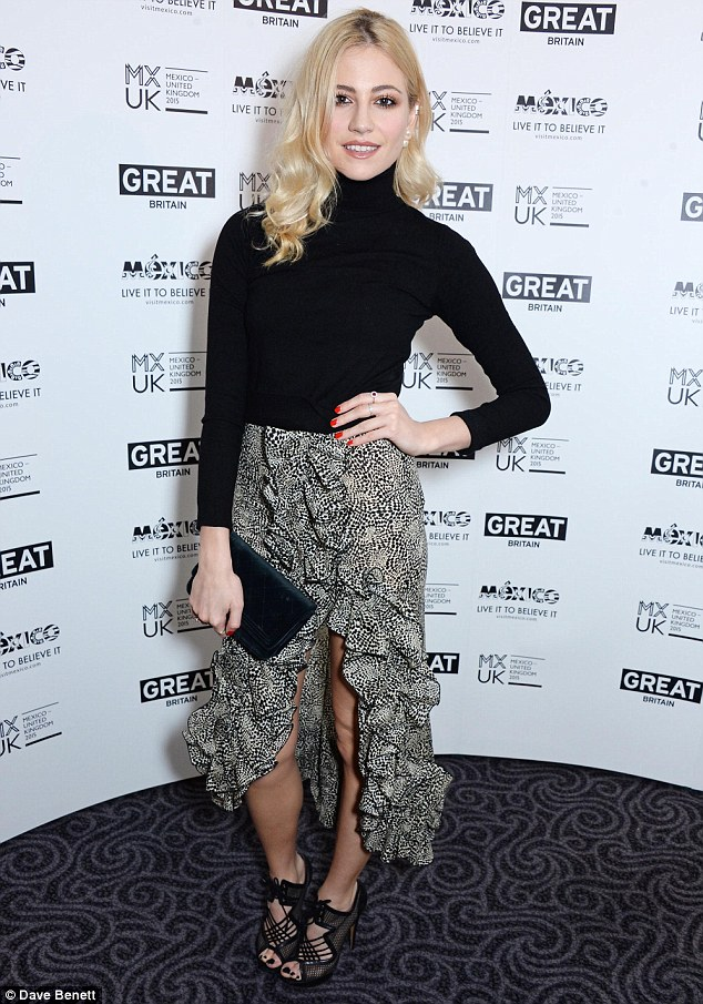 Dressed to impress: Pixie's Spanish style skirt showed off her figure and her long legs
