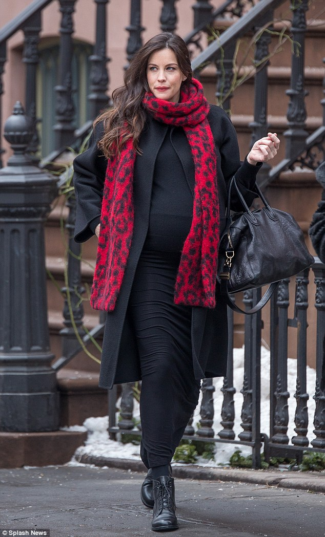 Pregnancy chic: Liv Tyler managed to mix comfort with style on Tuesday as she stepped out in New York's West Village