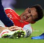 10 February 2015 - Barclays Premier League - Arsenal v Leicester City - Alexis Sanchez of Arsenal reacts to a knee injury picked up in a tackle from Matthew Upson of Leicester City - Photo: Marc Atkins / Offside.