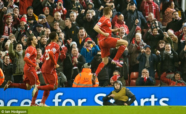Steven Gerrard (right) celebrates after scoring from the spot and giving Liverpool the lead