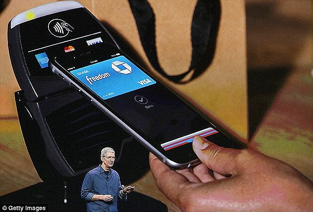PayPal isn't the only payment service to collaborate with a fuel giant. Customers at Chevron stations will soon be able to choose to purchase fuel using Apple Pay, shown here by Tim Cook at Apple's conference