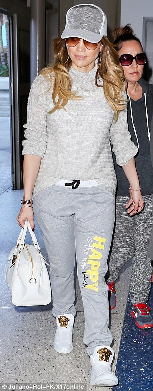 Their romance has wings: Jennifer Lopez was seen entering LAX airport on Tuesday morning; minutes later her on-again beau Casper Smart trailed behind