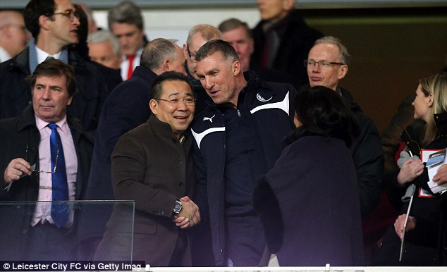 Leicester City owner Vichai Srivaddhanaprabha shakes hands with manager Nigel Pearson at the Emirates