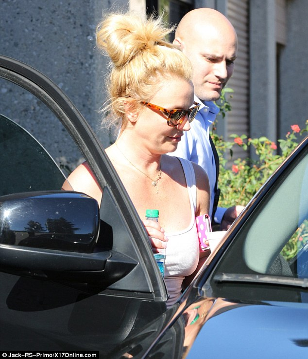 Hair raising: The Stronger singer wore her blonde locks in a messy updo which she showed off as she got into a black vehicle