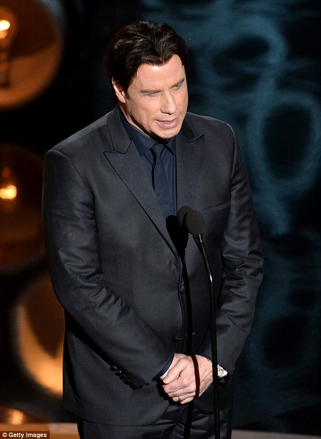 Don't stuff it up this time:John Travolta has been given another chance to present at the Oscars despite struggling last year (pictured) to pronounceIdina Menzel's name