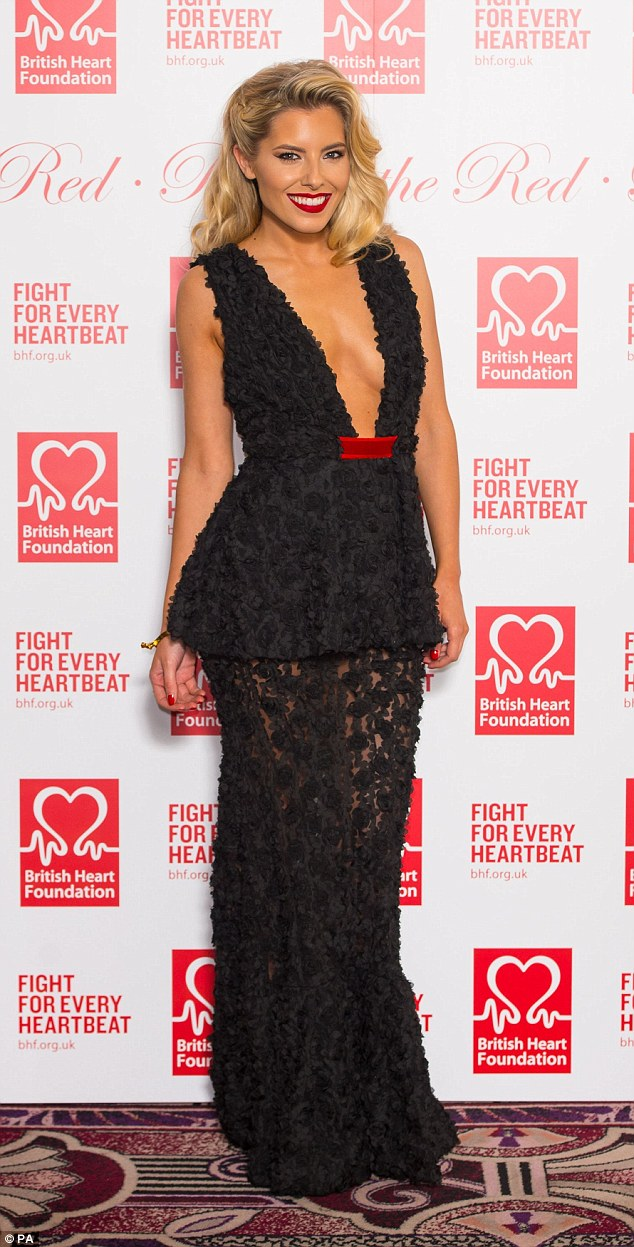 Hot number: The Saturdays singer, who acted as host of the British Heart Foundation fundraiser, ensured she would keep guests' attention in the low-cut gown