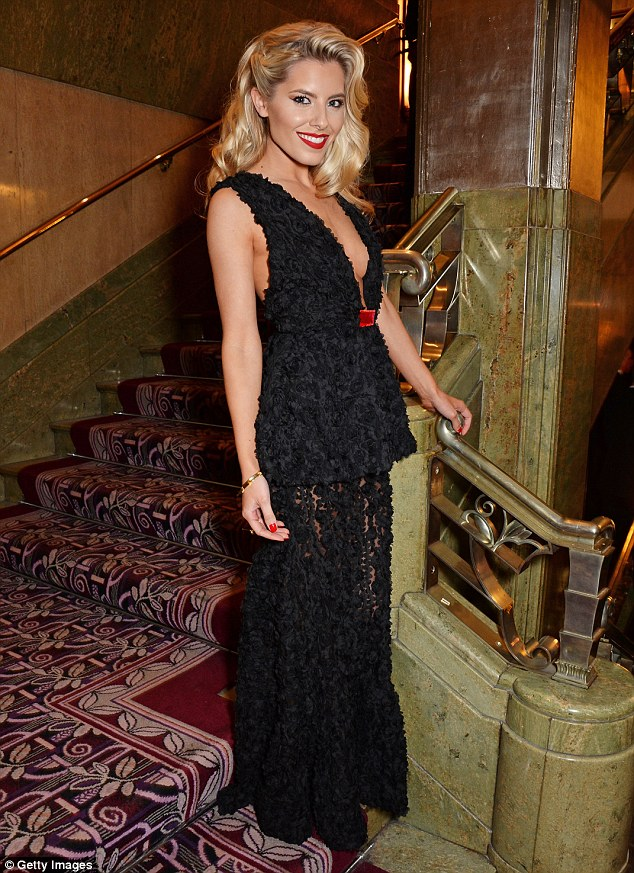 Hostess with the mostess: Mollie King arrived in a very daring number for the Roll Out The Red Ball on Tuesday