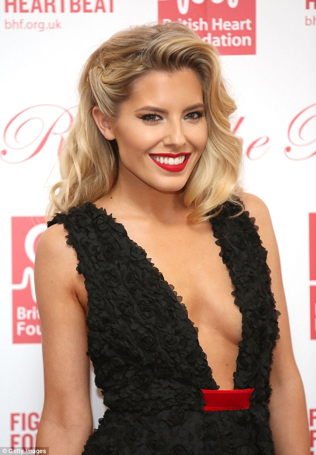 Old school glamour: Mollie harked back to the golden days of Hollywood with her hair and make-up, opting for soft golden waves and a red lip