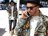 EXCLUSIVE: Lewis Hamilton wears a bright jacket and chats on his phone in Beverly Hills, California. The Formula 1 star, who has recently split again with his on-off girlfriend Nicole Scherzinger, looked downcast as he strolled through the exclusive area of Los Angeles. He and Nicole have been dating on and off for seven years. Standing out in a cream sweater and a tropical print jacket, Lewis also sported a black hat and Saint Laurent high top shoes.   Pictured: Lewis Hamilton Ref: SPL947541  100215   EXCLUSIVE Picture by: Splash News  Splash News and Pictures Los Angeles: 310-821-2666 New York: 212-619-2666 London: 870-934-2666 photodesk@splashnews.com