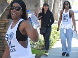 EXCLUSIVE: Kelly Rowland, the beautiful singer and new mother, looks happy as she exits the gym. Kelly's trainer Jeanette Jenkins is seen by her side looking like a fine example of her work in Los Angeles.   Pictured: Kelly Rowland and Jeanette Jenkins Ref: SPL948175  100215   EXCLUSIVE Picture by: Vladimir Labissiere/Splash News  Splash News and Pictures Los Angeles: 310-821-2666 New York: 212-619-2666 London: 870-934-2666 photodesk@splashnews.com
