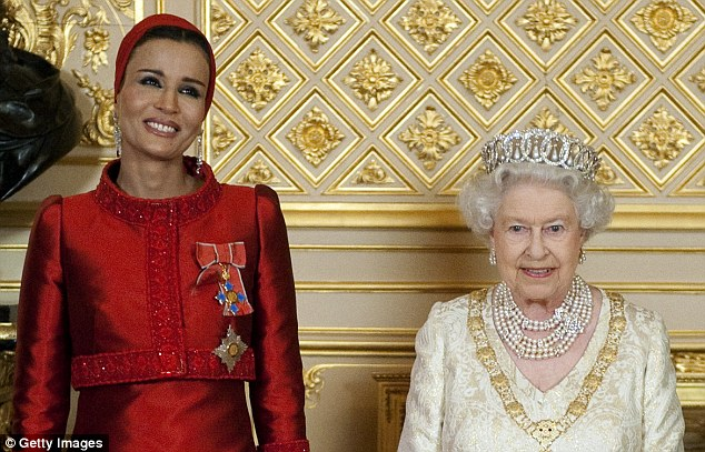 Contradictions: Sheikha Mozah, seen here with the Queen in 2010, embodies Qatar's contradictions