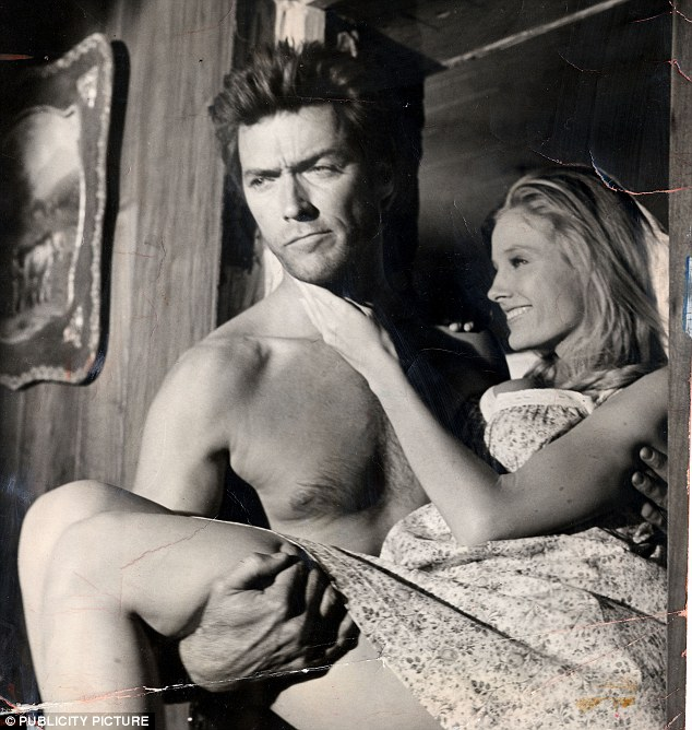 Runs in the family: It's easy to see that Scott gets his dashing good looks from his father Clint (pictured on the set of Coogan's Bluff in 1969 with co-star Melodie Johnson)