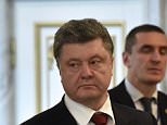 "Ukrainian President Petro Poroshenko (C) leaves a hall at the presidential residence in Minsk, on February 12, 2015, during a meeting aimed at ending 10 months of fighting in Ukraine. There is ""hope"" that an agreement on the 10-month Ukraine conflict will be signed soon by a contact group that is meeting in parallel with a marathon four-way peace summit in Minsk, a diplomatic source told AFP on February 12. AFP PHOTO / KIRILL KUDRYAVTSEVKIRILL KUDRYAVTSEV/AFP/Getty Images"