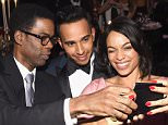 NEW YORK, NY - FEBRUARY 11:  Chris Rock, Lewis Hamilton and Rosario Dawson attend the 2015 amfAR New York Gala at Cipriani Wall Street on February 11, 2015 in New York City.  (Photo by Larry Busacca/Getty Images)