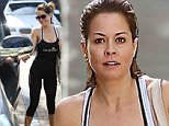 Please contact X17 before any use of these exclusive photos - x17@x17agency.com   Brooke Burke looking tiny in black spandex leaving yoga with some female friends in Malibu.   February 11, 2015 X17online.com