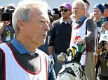 PEBBLE BEACH, CA - FEBRUARY 11:  Actor Clint Eastwood switches roles with his caddie for the day Nick Faldo on the 18th tee during the 3M Celebrity Challenge before the AT&T Pebble Beach National Pro-Am at the Pebble Beach Golf Links on February 11, 2015 in Pebble Beach, California.  (Photo by Harry How/Getty Images)