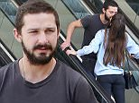 February 11, 2015: Shia Labeouf monkey around with girlfriend Mia Goth on a mall escalator while out shopping in Los Angeles, California.\nMandatory Credit: Fresh/INFphoto.com\nRef: infusla-284