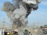 epa04612674 Smoke billows from the scene of a suicide bomb blast that targeted a police headquarters in Kunduz, Afghanistan, 10 February 2015. Five Taliban fighters were killed when they attacked a police headquarters in northern Afghanistan on 10 February, officials said. One attacker blew himself up at the entrance and four others were shot dead, said Sayed Sarwar Hussaini, police spokesman for Kunduz province. No police died, but 'an officer and a woman passerby were injured,' he said.  EPA/JAWED KARGER