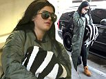 Kylie Jenner spotted catching a flight out of Los Angeles wearing brown work boots, an army green jacket, tight black jeans while carries a zebra print blanket & her trusty iPhone.  Pictured: Kylie Jenner Ref: SPL949074  110215   Picture by: Sharky / Splash News  Splash News and Pictures Los Angeles: 310-821-2666 New York: 212-619-2666 London: 870-934-2666 photodesk@splashnews.com