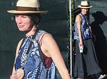 UK CLIENTS MUST CREDIT: AKM-GSI ONLY EXCLUSIVE: Pregnant Lena Headey shows off her baby bump in style while talking with her carpenters at her remodel property in Los Angeles on Wednesday. The 'Game of Thrones' star fought the bright sun as she exited her property with some men.  Pictured: Lena Headey Ref: SPL949614  110215   EXCLUSIVE Picture by: AKM-GSI / Splash News