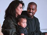 NEW YORK, NY - FEBRUARY 12:  Kim Kardashian, North West and Kanye West attend the adidas show during Mercedes-Benz Fashion Week Fall 2015 at Skylight Clarkson SQ. on February 12, 2015 in New York City.  (Photo by Gary Gershoff/WireImage)
