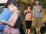 UK CLIENTS MUST CREDIT: AKM-GSI ONLY EXCLUSIVE: **NO FRANCE**  Milla Jovovich gets a jump start on her post-baby body as she goes for a hike with her husband Paul W.S. Anderson this afternoon in Beverly Hills.  The pregnant actress' bulging baby bump was on full display beneath a tank top paired with black leggings, trainers and a Death Race ball cap. The expectant couple, who was joined by their dogs, worked up a sweat as temperatures climbed into the 80's.  Pictured: Milla Jovovich, Paul W.S. Anderson Ref: SPL950686  120215   EXCLUSIVE Picture by: AKM-GSI / Splash News