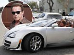 Please contact X17 before any use of these exclusive photos - x17@x17agency.com   Arnold Schwarzenegger driving his almost 2 million dollar Veyron Bugatti the car retails for an estimated $1,914,000. He's leaving lunch with a friend in LA.   February 11, 2015 X17online.com