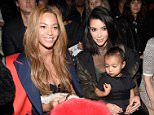 NEW YORK, NY - FEBRUARY 12: (L-R) Beyonce, Kim Kardashian, and daughter North attend the adidas Originals x Kanye West YEEZY SEASON 1 fashion show during New York Fashion Week Fall 2015 at Skylight Clarkson Sq on February 12, 2015 in New York City.  (Photo by Kevin Mazur/Getty Images for adidas)