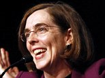 FILE - In this Nov. 6, 2012 file photo, Oregon Democratic Secretary of State Kate Brown celebrates at the podium after winning her race at Democratic headquarters in Portland, Ore.  Brown, a fellow Democrat, is widely considered to be to the left of Gov. John Kitzhaber, who is under mounting pressure to leave office because of an influence-peddling scandal involving his fiancee. If he resigns,  Brown would also become the first openly bisexual governor in the nation.   (AP Photo/Don Ryan, File)