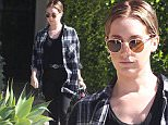 Picture Shows: Ashley Tisdale  February 12, 2015\n \n Actress Ashley Tisdale is seen leaving the The Andy Lecompte salon in West Hollywood, California with wet hair. \n \n Ashley's husband Christopher French recently wrote the music for the ABC sitcom 'Young & Hungry,' which is produced by Ashley. \n \n Exclusive - All Round\n UK RIGHTS ONLY\n \n Pictures by : FameFlynet UK � 2015\n Tel : +44 (0)20 3551 5049\n Email : info@fameflynet.uk.com