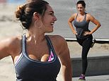 Splash News and Pictures EXCLUSIVE: Kelly Brook was pictured being put through a vigorous exercise regime by a private trainer as she hit the beach in Los Angeles. The 35 year old model/actress showed off a colourful workout bra underneath a revealing grey top that showed beachgoers her cleavage. She matched her outfit with tight black leggings, bright sneakers and showed off her tanned arms. At one point the 'Piranha 3D' actress had her tongue sticking out and gritted her teeth as she performed a difficult leg exercise with her hands in a praying position and an exercise rope between her legs. With her hair tied back she also felt her backside after a tough lunging routine laughing with her trainer. Finally, after the hour long work out she sat down with a frown on her face and a bottle of water. She is about to star in the American television sitcom 'One Big Happy'  which is produced by Ellen Degeneres. (Picture taken: 11/02/2015) ----------------------------------- For further sale